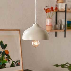 An ivory light with exposed light bulb is suspended from the ceiling. photo