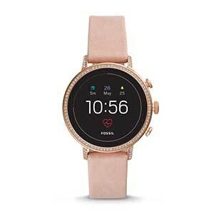 Blush pink Fossil smartwatch with crystals around the face photo