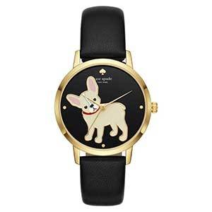 Gold watch with black band and black face and a French bulldog with a tilted head in the center of the face photo