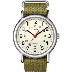 Silver watch with beige face, large black numbers and olive green strap with a cream face photo