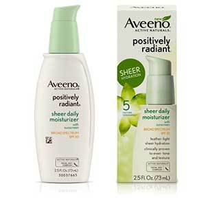 A white and green pump bottle of Aveeno moisturizer next to the box packaging. photo