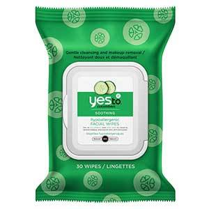 A green package of Yes to Cucumbers facial towelettes with illustrations of cucumbers. photo