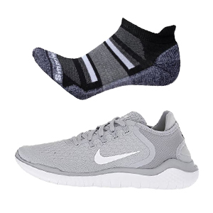 Light micro socks in black/gray above a pair of gray/white nike tennis shoes. photo