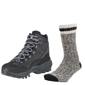 Black, gray, and white Merino wool raag crew socks next to a black pair of hiking boots. photo