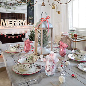 Table decorated with holiday decor and lantern centerpiece photo