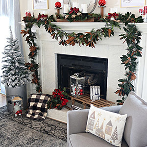 Fireplace decorated with greenery and buffalo check accents photo