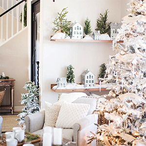 White holiday decor and frosted Christmas tree photo