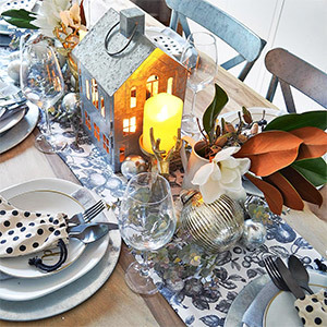 Dining table decorated with ornaments and greenery photo