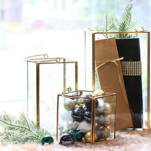Gold lanterns filled with ornaments photo