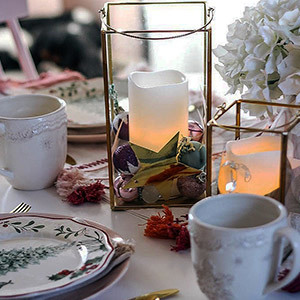 Gold lanterns on a dining table photo