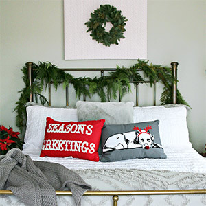 Bed with greenery garland on a headboard photo