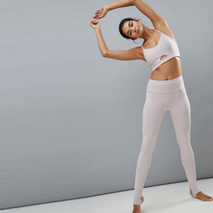 Pale pink sports bra with matching stirrup leggings. photo