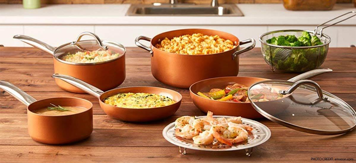 Copper cookware set with pans, skillets, pots, and strainer