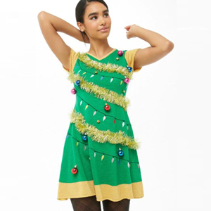 Green and yellow dress with tinsel trim and ornaments on it to look like a Christmas tree. photo