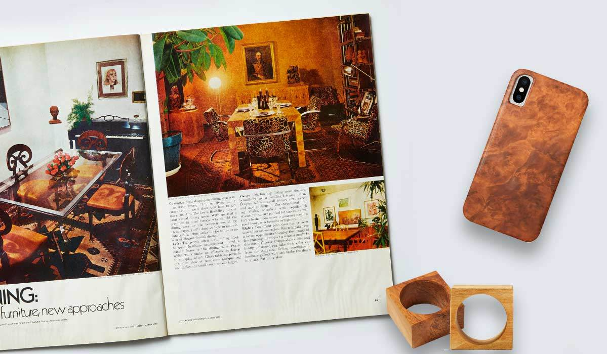 Better Homes & Gardens® old magazine with phone case and napkin rings by it photo
