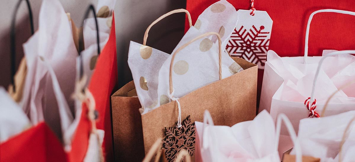 Red and brown holiday gift bags with tissue