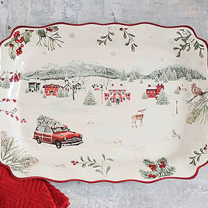 Holiday printed serving plate with Christmas trees and snow. photo