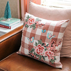 Floral plaid pillow with butterflies and roses. photo
