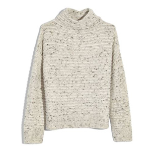 White sweater with a high neckline and speckled print photo