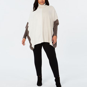 Turtleneck poncho sweater with a neutral colorblock design photo