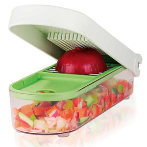 Green and white vegetable chopper with clear storage container underneath. photo