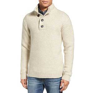 Off-white textured henley sweater with brown buttons at the front and along the collar. photo