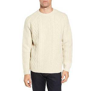 Cream-colored crewneck sweater in a fisherman knit pattern. photo