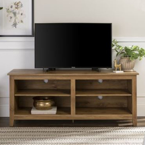 Wood TV stand with four shelves with a black flatscreen TV on it. photo