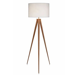 Tripod floor lamp with a white shade and wood base photo