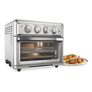 Silver toaster oven with four dials and two racks for air frying or baking photo