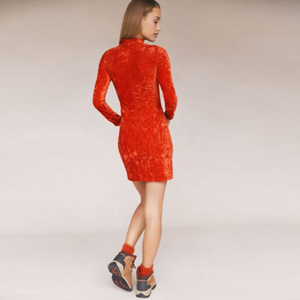 Red velvet mini dress with a high neckline and long sleeves. photo