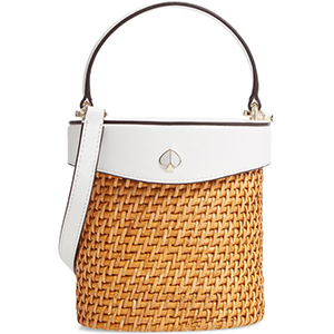 Rattan bucket bag with white top and crossbody strap. photo