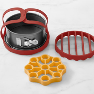 Four-piece kit including a cake pan, two silicone racks, and a silicone lifter photo