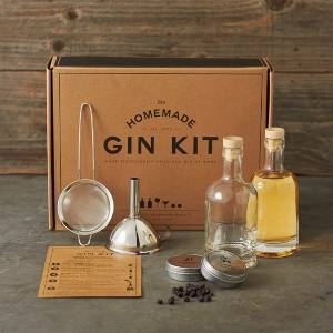 Brown box with gin-making supplies set in front. photo