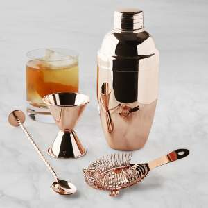 Copper shaker, spoon, jigger, and strainer. photo