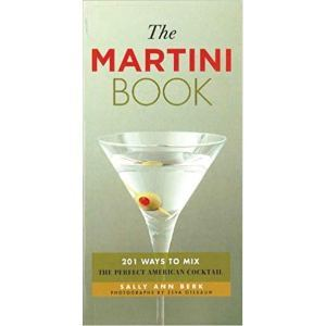 Green book with a photo of a martini with an olive on the cover. photo
