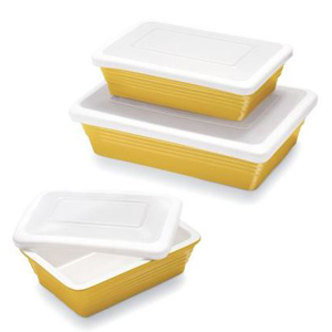 Three yellow stoneware baking dishes with lids in various sizes from Sur La Table photo