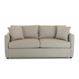 Light gray sofa with two cushions and two throw pillows. photo