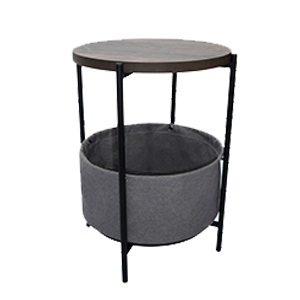 Round accent table with gray basket below for storage with four legs. photo