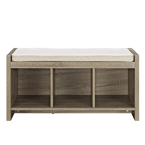 Wooden storage bench with three cubbies and white cushion. photo