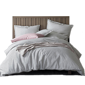 Gray king size duvet cover set with wooden headboard and four pillows. photo