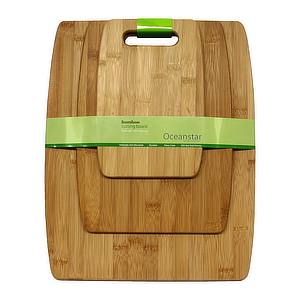 Bamboo wood cutting board set with green bands around photo
