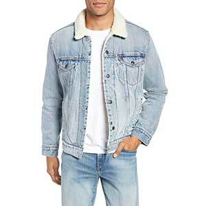 Light blue denim Levi's jacket with white shearling lining the inside photo