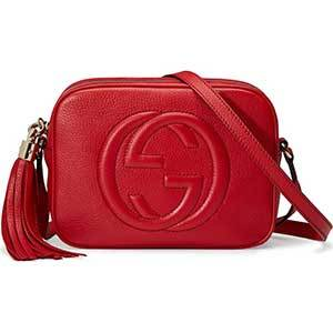 Small red leather purse with large Gucci logo embossed on the front photo