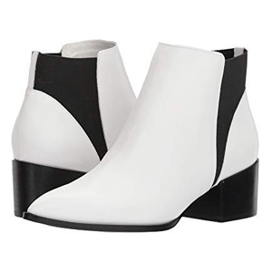 White booties with black accents on the heel and back side photo