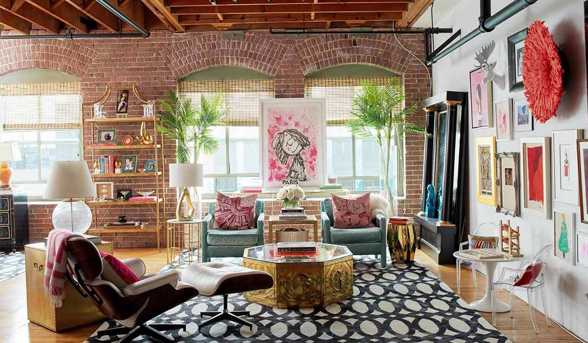 Colorful living room with various prints and artwork. photo