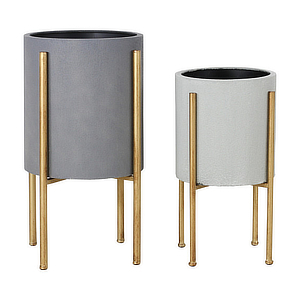 Midcentury-modern planters with gold legs. photo