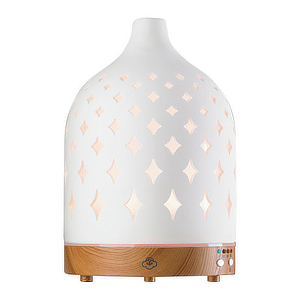 White electric diffuser with a diamond cut-out design. photo