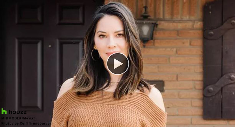 A picture of Olivia Munn in an orange sweater. photo