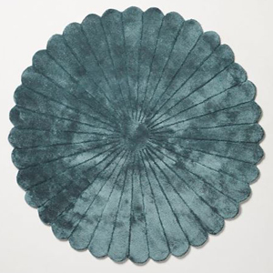 Round teal rug from Anthropologie photo